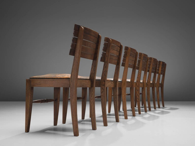 French Gaston Poisson Set of Six Leather and Oak Dining Chairs For Sale