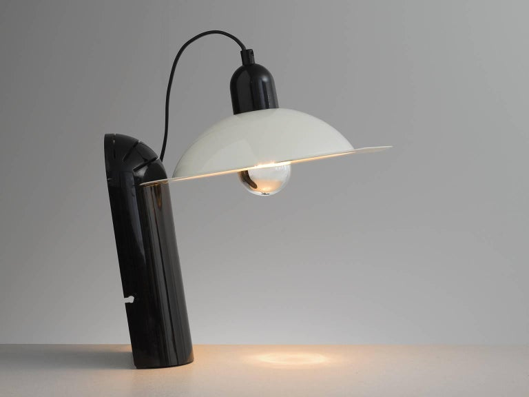 Jonathan de Pas, Donato d'Urbino, and Paolo Lomazzi for Stilnovo, lampiatta table lamp, Italy, 1971.   It is made from lacquered metal and plastic and the lampshade can be moved to create different illumination effects. Bottom part in Black. The