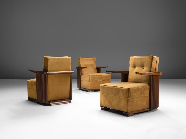 Lounge chairs, oak and ocre velvet, France, 1930s  This unique design features cow horn-shaped armrests, thick cushions and carved, closed, striped sides. The legs consists of two horizontal, flat oak carved pieces of oak. Providing this set with
