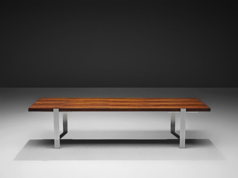 Coffee table, rosewood and stainless steel, the Netherlands, 1960s.  The rectangular top is made with rosewood veneer slats, in wonderful different tones. The warm expression of the basic top beautifully contrasts to the thin straight steel legs.