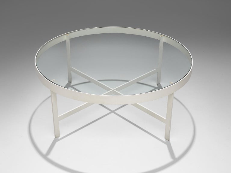 Janni van Pelt, coffee table, glass and white metal, the Netherlands, circa 1958.   Round coffee table in white coated metal and glass. This table is a variation on Janni van Pelts model G4. The base consists of four legs with a cross-connection.