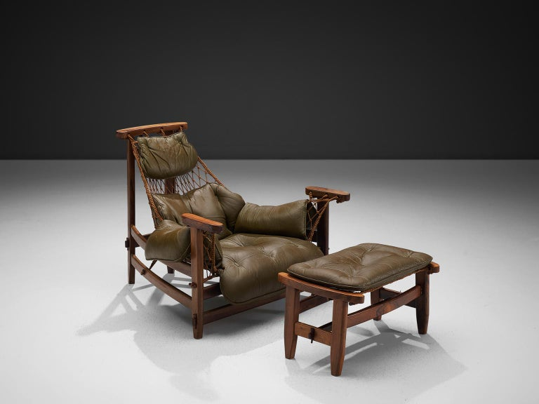 Jean Gillon, 'Jangada' armchair and ottoman, rosewood, nylon rope, leather, Brazil, 1968.  This robust and hefty armchair is designed by Jean Gillon. The originality of this Janganda comes from the concept of the body being captured by the piece