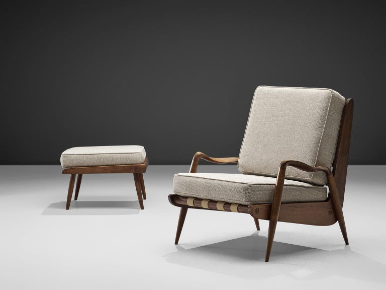 Philip Lloyd Powell, lounge chair with ottoman, american walnut and grey fabric, United States, 1960s.   This sculptural armchair and matching ottoman are executed in American walnut and recently upholstered thick grey fabric. It is extremely rare