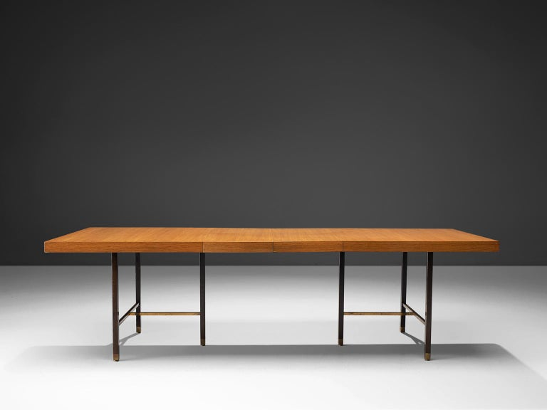Harvey Probber Inc., mahogany and stained mahogany for the legs, brass, USA, circa 1955.  This Minimalist, modest table is designed by Harvey Probber. The top, executed in warm mahogany forms a striking balance with the dark stained legs and the