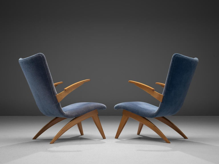 G. Van Os for Van Os Culemborg, set of armchairs, beech and fabric, The Netherlands, 1950s.  This set of easy chairs is designed by G. Van Os in The Netherlands. These lounge chairs, executed in beech and blue fabric have backrests that are