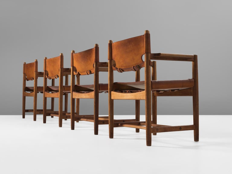 Børge Mogensen for Fredericia Stolefabrik, set of 4 armchairs model 3238, in oak and leather, Denmark, 1964.   Set of four armchairs in solid oak. These chairs remind of the classical foldable 'director-chairs', yet this design by Danish designer