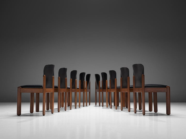 Silvio Coppola for Bernini Italy, set of 10 chairs, black leather and stained beech, Italy, 1960s.   Set of ten chairs by Italian designer Silvio Coppola. These chairs have a cubic and architectural appearance. The base consist of four straight