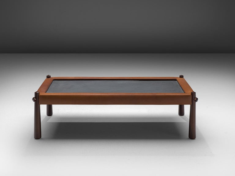 Percival Lafer, coffee table, slate, leather and rosewood, Brazil, 1970s  This coffee table by Brazilian designer Percival Lafer features a slate chalkboard surface. The tabletop is embedded with cognac leather which is very notable. The rosewood