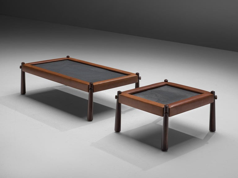 Percival Lafer, pair of coffee tables, slate, leather and rosewood, Brazil, 1970s  These coffee tables by Brazilian designer Percival Lafer feature a slate chalkboard surface. The tabletop is embedded with cognac leather which is very notable. The