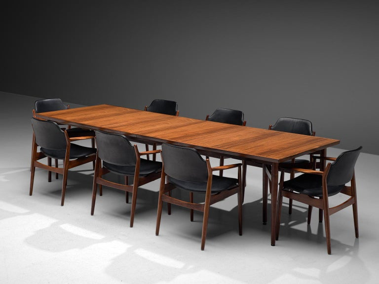 Arne Vodder, extendable dining table with set of 8 dining chairs, rosewood, Denmark, 1960s.   This large conference table with chairs by Arne Vodder are a true example of the combination of slender and architectural design with rounded colors and