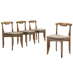 Guillerme et Chambron Set of Four Dining Chairs with Beige Upholstery