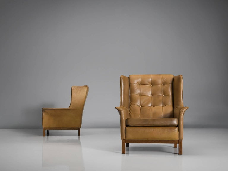 Highback chairs, in leather and wood by Arne Norell, Sweden, 1960s.