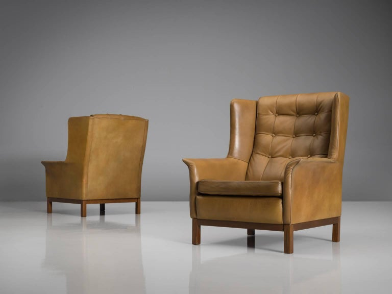 Scandinavian Modern Arne Norell Matching Pair of High Back Chairs in Patinated Cognac Leather
