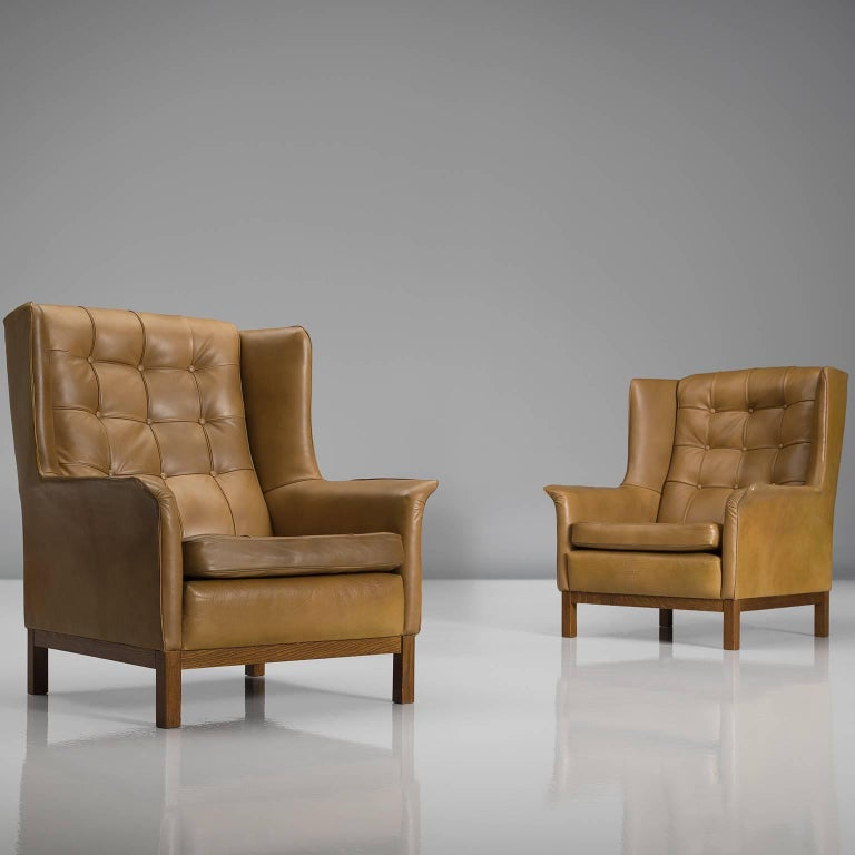 Wood Arne Norell Matching Pair of High Back Chairs in Patinated Cognac Leather