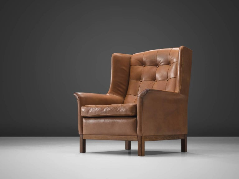 Arne Norell, high back chair, cognac leather and wood, Sweden, 1960s. 