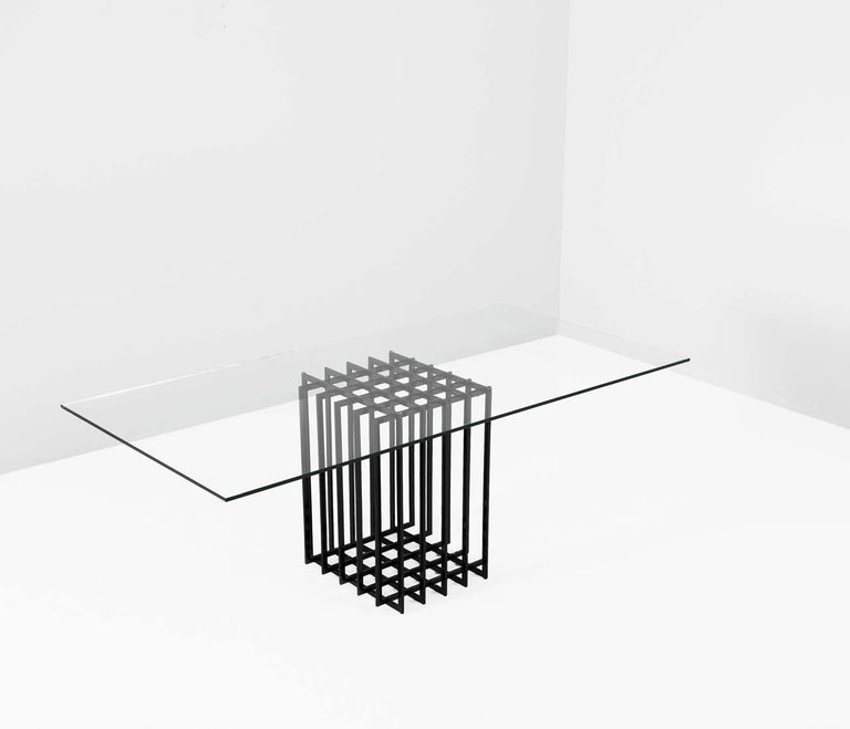 Table, in glass and metal, by Pierre Cardin, France, 1960s.   Architectural writing or dining table by Pierre Cardin in black-coated steel. Due the use of a grid, the table features an elegant open expression. The clear glass top beautifully