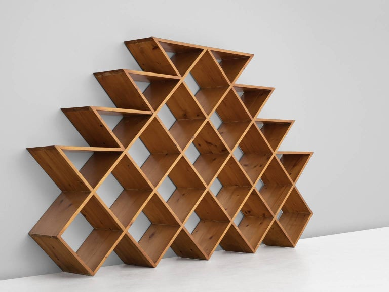 Wall unit, in pine, Europe 1960s.   Graphical bookcase in solid pine. These shelves consist of several piled cubes formed into a pyramid. The diagonal lines are alternate by horizontal lines on the sides of the cabinet. A beautiful rhythm is