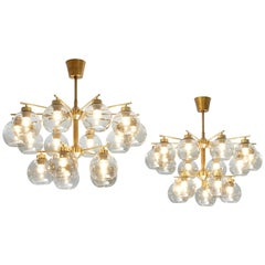 Hans-Agne Jakobsson Set of Three Chandeliers in Brass and Smoked Glass