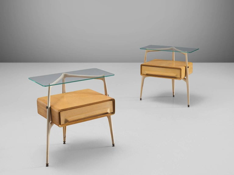 Silvio Cavatorta, maple and beech, brass, glass, Italy, 1950s.  These two delicate and sculptural bedside tables are designed by the Italian Silvio Cavatorta. The little maple cabinets feature one drawer each and have a tripod frame. The frame is