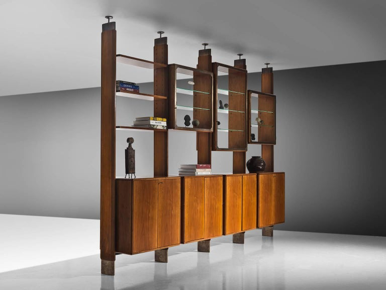 BBPR for Pierino Frigerio, wall unit, Italian walnut, Italy, circa 1962.  This cabinet is designed by studio BBPR and executed by Pierino Frigerio. It is a truly marvelous piece by the architectural collective. The library wall is was made for a