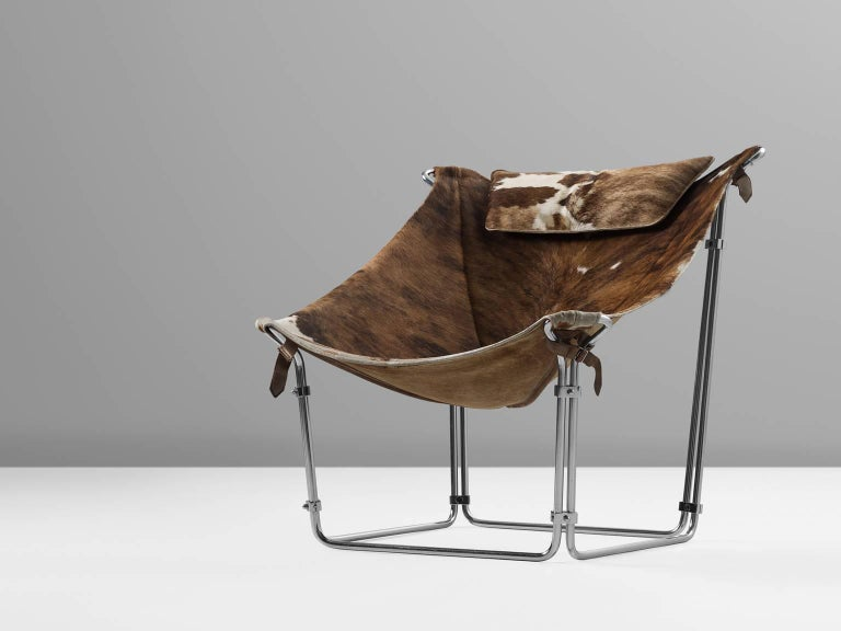 Chair, cow hide, tubular steel, Steiner, Paris, 1969.  This extraordinary lounge chair by Kwok Hoi Chan is produced by Steiner, Paris. What marks this design is the frame made of tubular steel, covered with a beautiful hide.  Kwok Hoi Chan