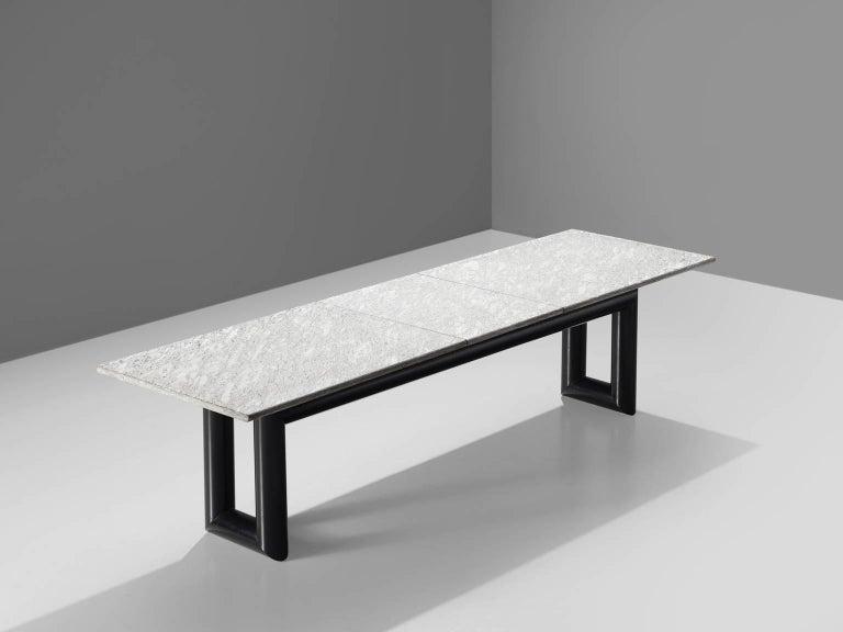 Mario Botta for Alias, conference table, metal and stone, Italy, 1983.  This sturdy table features two u shaped thick metal legs and a large, solid grey marble top. The metal base is painted black and forms a wonderful contrast with the long