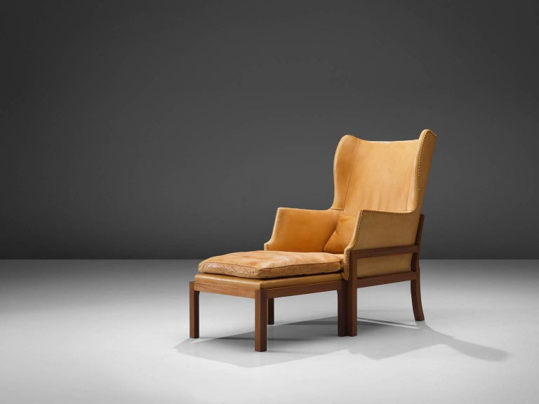 Mogens Koch for Ivan Schlechter, wingback chair and ottoman, cognac leather, mahogany, Denmark, design 1936, manufactured 1970.