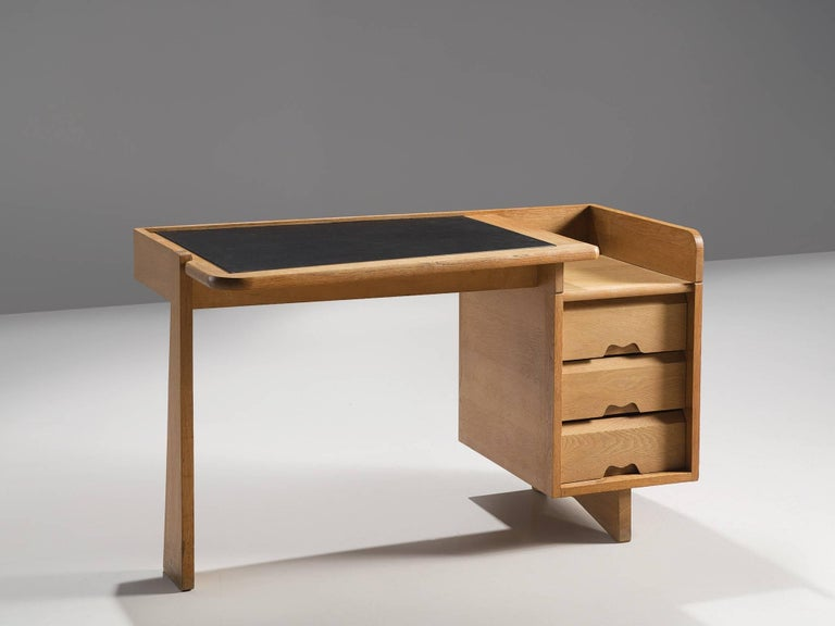 Guillerme et Chambron, desk, oak and leather, France, 1960s.   This small desk is designed by the French designer duo Guillerme and Chambron. This writing desk holds the characteristic decorations and lines of this duo such as the decorative