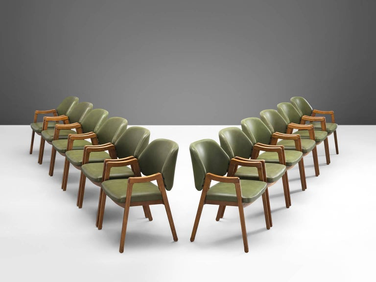Twelve armchairs by Ico Parisi for Cassina, beech and leatherette, Italy, 1963.  This large set of green conference chairs '814' were are executed to perfection and provide great comfort. These chairs look almost sculpted thanks to the exquisite