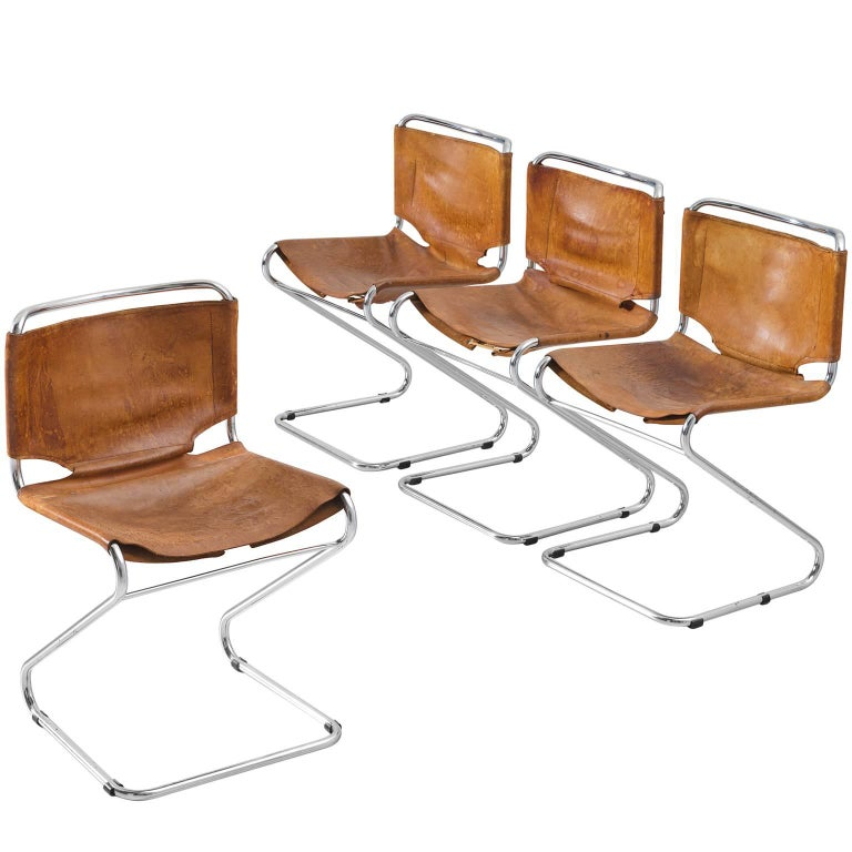 Set Of Four Tubular Dining Chairs With Patinated Cognac Leather Upholstery For