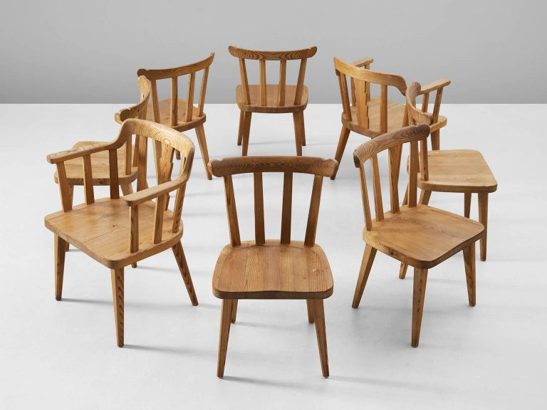 Set of eight chairs Ekero¨, in pine, Sweden, 1930s.  Elegant set of six dining chairs and two armchairs. Executed in northern European pinewood with stunning patina. The design is simplistic; four tapered legs, solid seating and spindle or slat