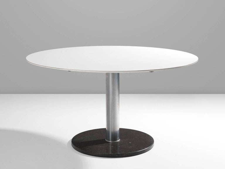 Dining table, in wood, metal and marble, by Alfred Hendrickx for Belform, Belgium, 1960s.   Pedestal dining room table with round white top on a chromed pedestal with black marble base. This table is designed by the well-known Belgian designer