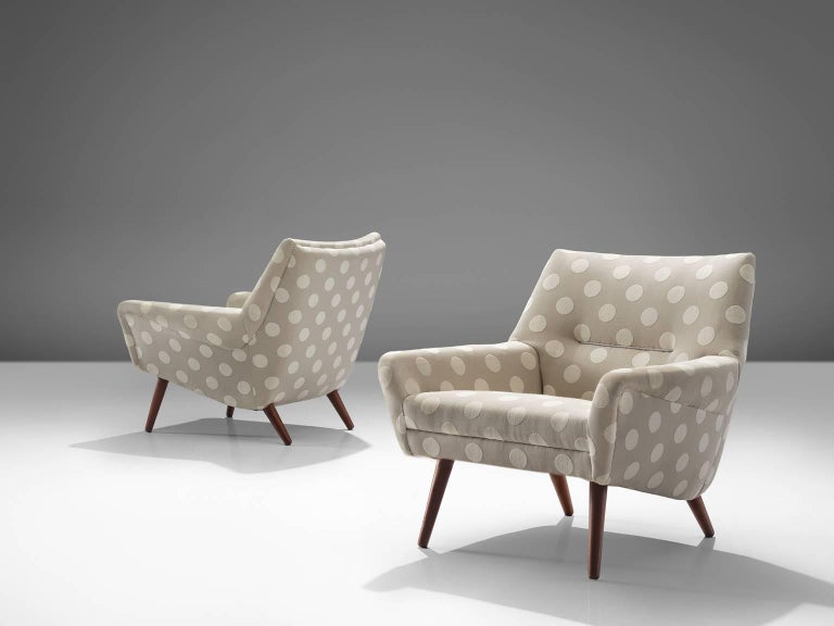 Easy chairs, grey and white dotted fabric, teak, Denmark, 1960s.  These armchairs show refined Danish craftsmanship and aesthetics. The backs feature a slightly tilted back and comfortable cushions in both the seat and back, as can be expected