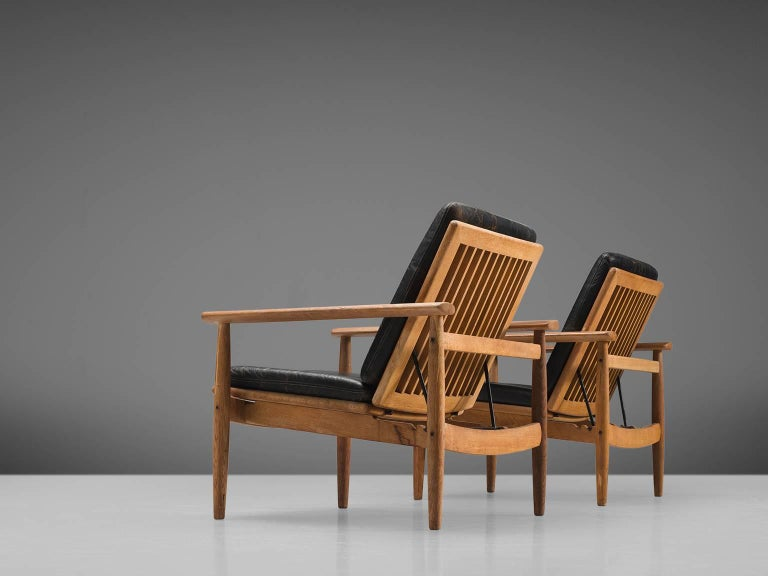 Johan Hagen, armchairs, oak, black leather, Denmark, 1960s.