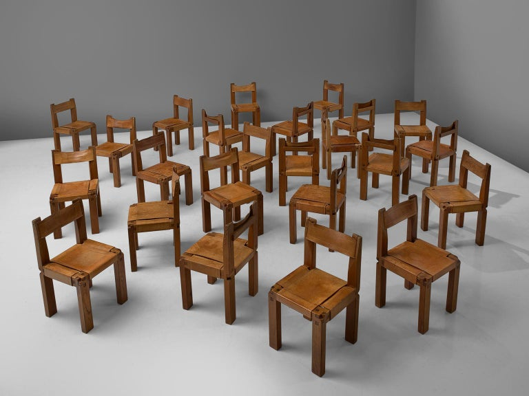 Pierre Chapo, set of 12 dining chairs, model S11, in elm and leather by France, circa 1966.  Large set of 12 chairs in solid elmwood with saddle leather seating and back. Designed by French designer Pierre Chapo in Paris. These chairs have a cubic