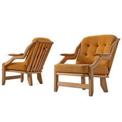 Pair of Orange Guillerme and Chambron Lounge Chairs