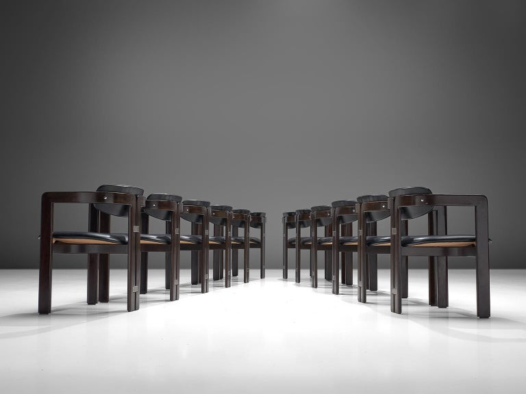 Augusto Savini for Pozzi, set of 12 'Pamplona' armchairs, dark blue leather, dark brown coated wood, metal, Italy, 1960s.  Set of twelve armchairs in dark brown coated wood and dark blue leather. The chairs have a unique and characteristic design;