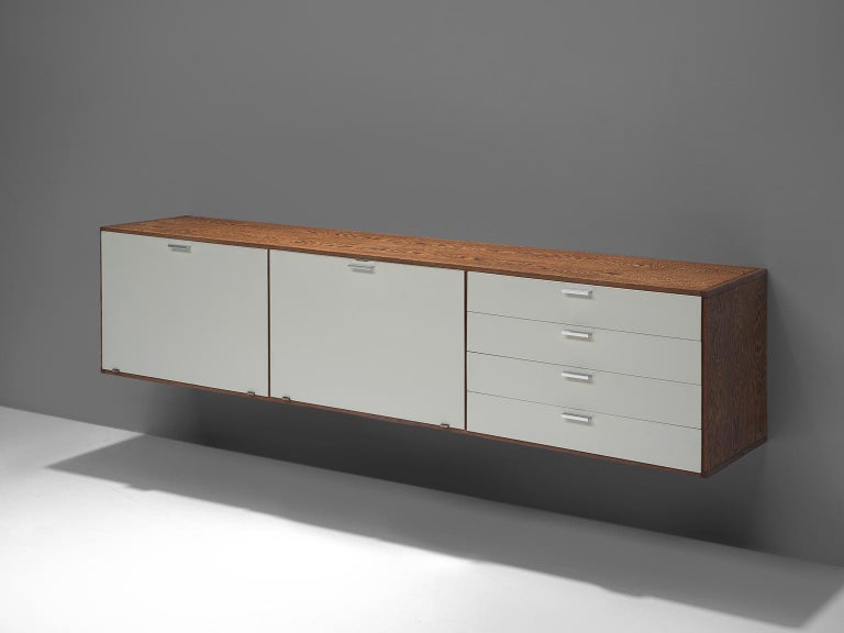 Cees Braakman for UMS Pastoe, wall-mounted sideboard, wengé, steel and lacquered wood, The Netherlands, circa 1960.