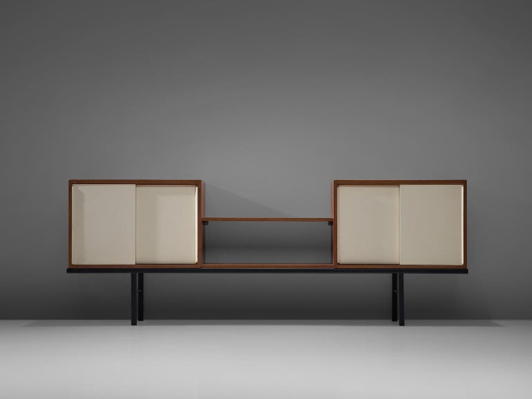 Martin Visser for 't Spectrum, pair of sideboards, Bornholm collection KW63, wood, metal, glass, The Netherlands, 1956-1959  This rare sideboard is executed in mixed materials. The credenza features a Minimalist black metal base and two cabinets