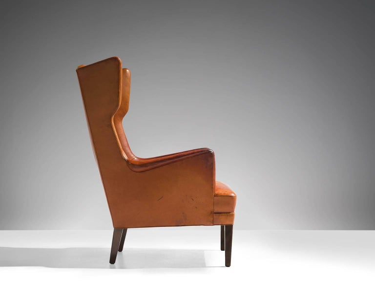 Scandinavian Modern Cognac Wingback Easy Chair Attributed to Frits Henningsen  For Sale