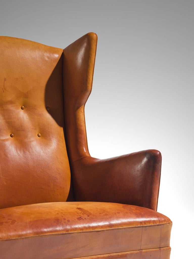 Mid-20th Century Cognac Wingback Easy Chair Attributed to Frits Henningsen  For Sale