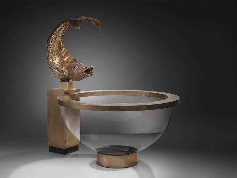 Luxurious fish fountain in brass and Lucite, France, 1960s  This unique and rare item most likely originates in France, circa 1960s.  The refined details of the brass fish clearly show the work of a true artist. Placed on a brass plated console,