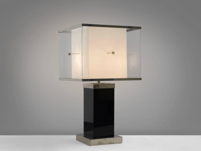 Romeo Rega, floor lamp, Lucite, Italy, 1970s.  This sculptural, cubical floor lamp features a small white base on which a deep black foot rests. On top of the black and white base stands a large shade. The design is typical for postwar, postmodern