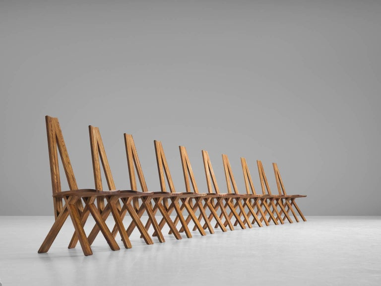 Set of ten 'Chlacc' chairs, in elm, by Pierre Chapo, France, circa 1979.  This set of ten 'Chlacc' dining chairs, model S45, are executed in solid elmwood. Designed by Pierre Chapo. These extraordinary chairs are in excellent condition, showing an