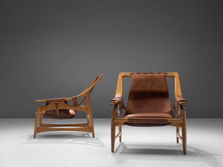 Mid-Century Modern W. Andersag Pair of Lounge Chairs in Teak and Brown Leather For Sale