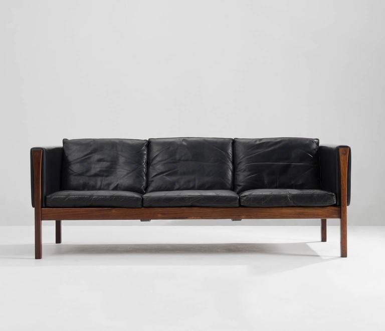 Fatastic Hans J. Wegner 3 seater sofa AP62 in black leather and rosewood, Denmark 