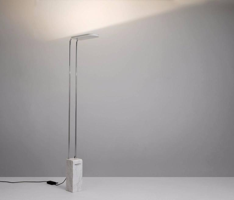 Floor lamp 'Gesto Terra' in marble, steel and acrylic, Italy, 1974.   Elegant floor lamp with marble base. The frame is from tubular steel. This is an uplight, which means the lux is on the upside of the lamp. In this way the halogen light gets