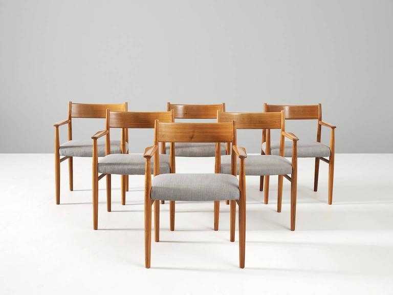 Dining room chairs model 418, in walnut and fabric, by Arne Vodder for Sibast Møbler, Denmark 1960s.   Set of six dining chairs by Arne Vodder. Model 418 is an elegant chair with armrests. This set is executed in walnut with a fabric upholstery.