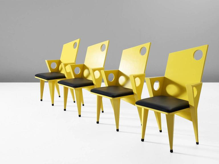 Set of four armchairs, in wood and faux-leather, Europe, 1980s.  Set of four frivolous armchairs in bright yellow. These Memphis style chairs are designed with angles and diagonal lines. Except from the seating all parts are basically designed
