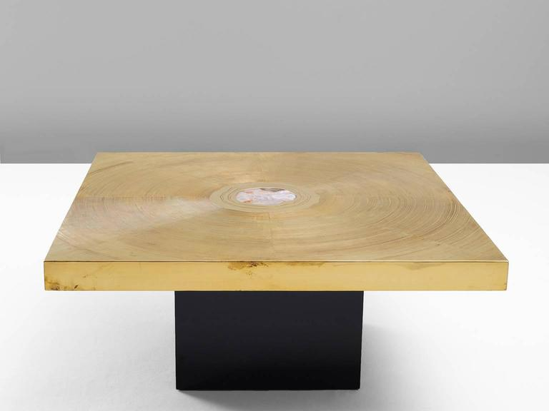 Coffee tables, in brass, gemstone and wood, Belgium 1970s  Signed Sculptural coffee table with beautiful etched brass top. This table is a piece of art on it's own. The square top shows a graphical spiral of lines in brass. In the middle is a